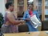 Ms L. Ntoampe Receiving a Farewell Gift from the office